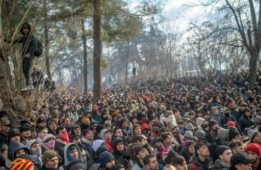 Some of the thousands of migrants gathered at the Turkish side of the border