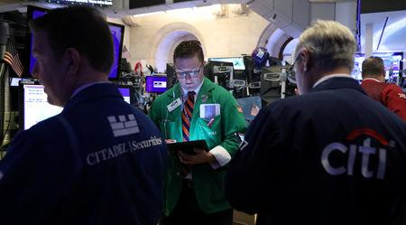 FILE PHOTO: Traders work on the floor at the New York Stock Exchange (NYSE) in New York, U.S., May 14, 2019. REUTERS/Brendan McDermid/File Photo
