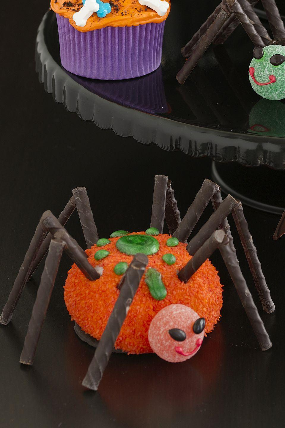 """<p>Not quite a cupcake: This recipe calls for Sno Balls to be decorated with chocolate sticks, Candy Melts, and frosting.</p><p><em><a href=""""https://www.womansday.com/food-recipes/food-drinks/recipes/a10888/large-sno-ball-spiders-122196/"""" rel=""""nofollow noopener"""" target=""""_blank"""" data-ylk=""""slk:Get the Large Sno Ball Spider recipe."""" class=""""link rapid-noclick-resp"""">Get the Large Sno Ball Spider recipe.</a></em></p>"""