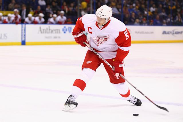 ST. LOUIS, MO - NOVEMBER 15: Nicklas Lidstrom #5 of the Detroit Red Wings shoots the puck against the St. Louis Blues at the Scottrade Center on November 15, 2011 in St. Louis, Missouri. (Photo by Dilip Vishwanat/Getty Images)