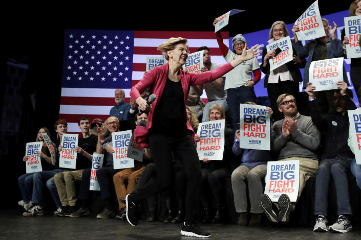Democratic presidential candidate Sen. Elizabeth Warren, D-Mass., runs on stage as she greets a supporter, not shown, at the start of a campaign stop, in Keene, N.H., Tuesday, Feb. 4, 2020. (AP Photo/Steven Senne)