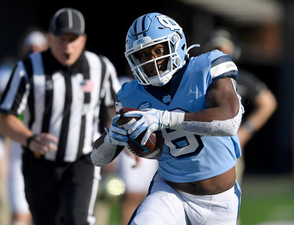 CHAPEL HILL, NORTH CAROLINA - NOVEMBER 14: Michael Carter #8 of the North Carolina Tar Heels runs against the Wake Forest Demon Deacons during their game at Kenan Stadium on November 14, 2020 in Chapel Hill, North Carolina. The Tar Heels won 59-53. (Photo by Grant Halverson/Getty Images)