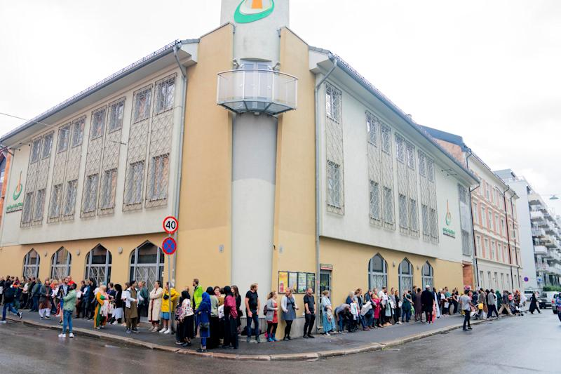 People gather outside the Islamic Cultural Centre to show solidarity with the Muslim community after Saturday's shooting at a mosque, in Oslo, Norway.