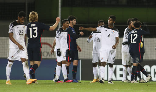 Players gesture to each other following the international friendly soccer match between the USA and Panama at the SC Wiener Neustadt stadium in Wiener Neustadt, Austria, Monday, Nov. 16, 2020. (AP Photo/Ronald Zak)