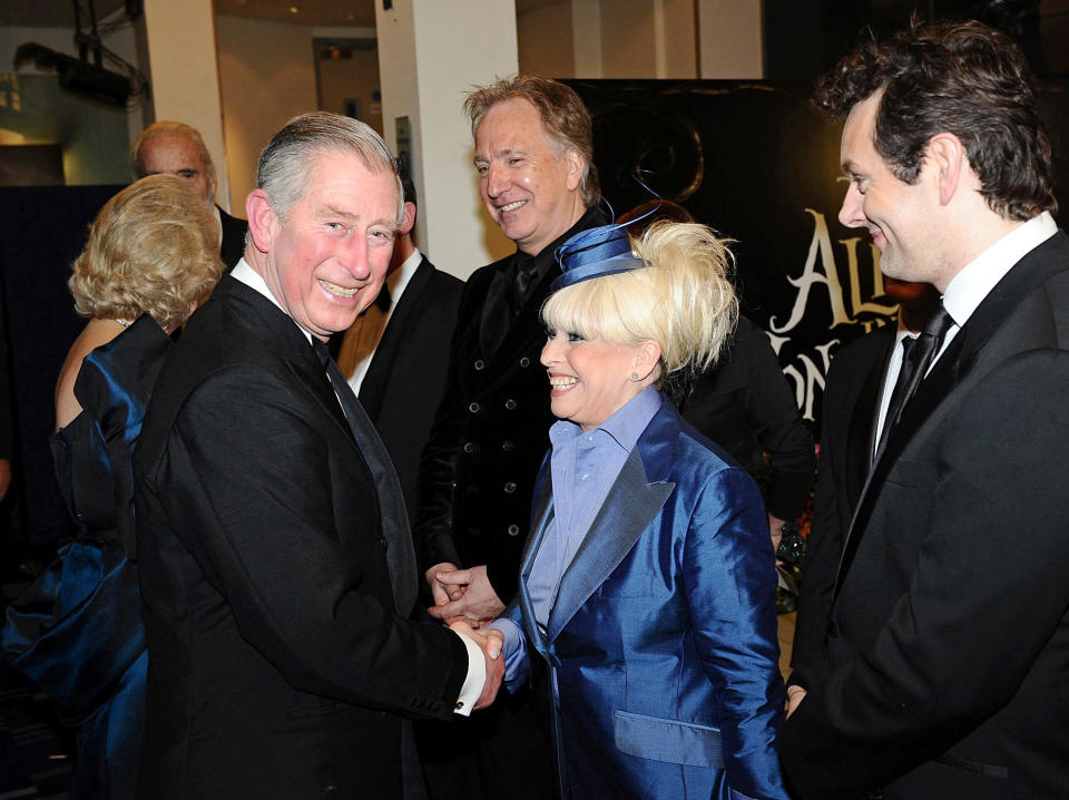 """Britain's Prince Charles (L) speaks with actress Barbara Windsor at the Royal World Premiere of """"Alice In Wonderland"""" in London February 25, 2010. REUTERS/Ian West/Pool (BRITAIN - Tags: ENTERTAINMENT ROYALS)"""