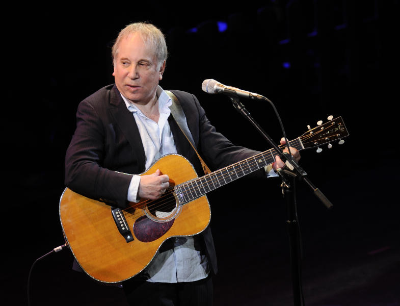 "FILE - This April 2, 2012 file photo shows singer Paul Simon performing at ""A Celebration of Paul Newman's Dream"" to benefit ""SeriousFun"" an association of Hole in the Wall Camps at Avery Fisher Hall in New York. Police in Connecticut say Paul Simon and his wife, singer Edie Brickell, have been arrested on disorderly conduct charges. A New Canaan police spokeswoman provided no other details, except to say the arrests stemmed from an incident Saturday. An arraignment in Norwalk Superior Court is expected Monday afternoon. Simon is a 12-time Grammy winner and a member of The Songwriters Hall of Fame and the Rock n' Roll Hall of Fame — as half of the duo of Simon and Garfunkel and as a solo artist. Brickell's ""What I Am,"" recorded with her band the New Bohemians, was a hit in 1988. The two were married in 1992. (AP Photo/Evan Agostini, File)"