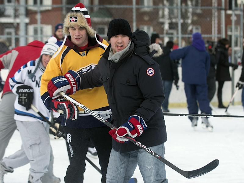 Montreal Canadiens defenseman Josh Gorges, right, watches the play during a game of pick-up hockey in Montreal, Wednesday, Dec. 26, 2012. Gorges used Twitter to organize a Boxing Day outdoor hockey game with fans at a neighborhood rink in Montreal. (AP Photo/The Canadian Press, Graham Hughes)