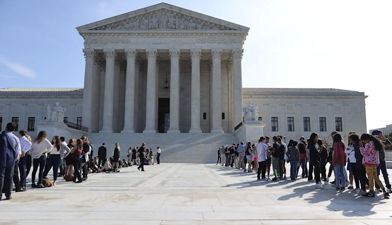Hundreds of people waited in line Monday for the chance to attend the first and second day of Supreme Court oral arguments. The high court addressed criminal cases Monday, but a separate line began forming Friday for Tuesday's debate about gay, lesbian and transgender employment rights.