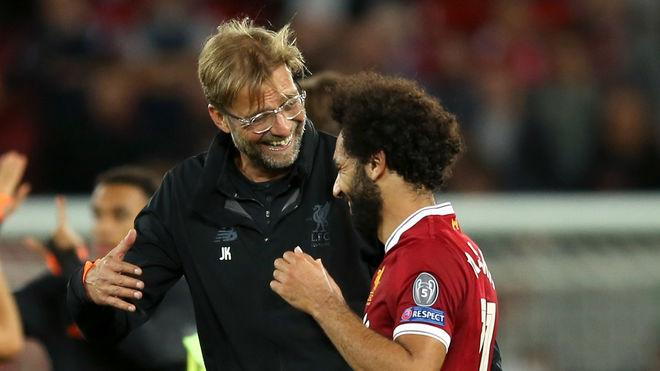 LIVERPOOL, ENGLAND - AUGUST 23: Jurgen Klopp, Manager of Liverpool and Mohamed Salah of Liverpool celebrate victory together after the UEFA Champions League Qualifying Play-Offs round second leg match between Liverpool FC and 1899 Hoffenheim at Anfield on August 23, 2017 in Liverpool, United Kingdom. (Photo by Jan Kruger/Bongarts/Getty Images)