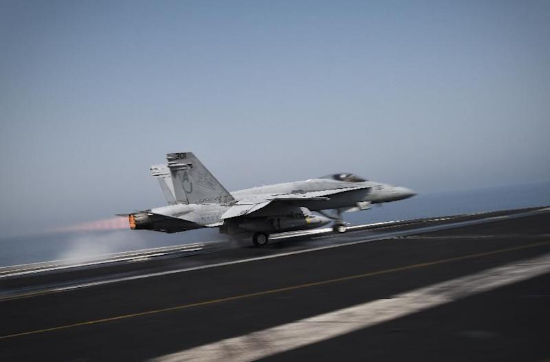 An F/A-18C Hornet takes off for Iraq from the flight deck of the US navy aircraft carrier USS George H.W. Bush on August 15, 2014 in the Gulf