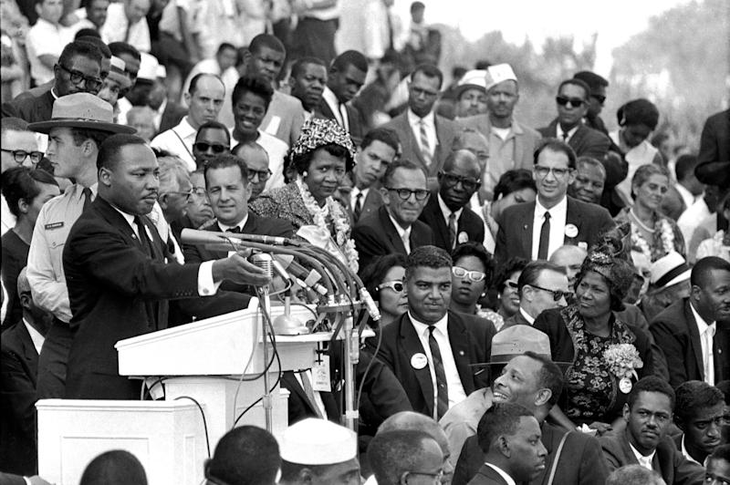"""FILE - In this Aug. 28, 1963 file photo, the Rev. Dr. Martin Luther King Jr., head of the Southern Christian Leadership Conference, speaks to thousands during his """"I Have a Dream"""" speech in front of the Lincoln Memorial for the March on Washington for Jobs and Freedom, in Washington. Actor-singer Sammy Davis Jr., is at bottom right. It has been cited as one of America's essential ideals, its language suggestive of a constitutional amendment on equality: People should """"not be judged by the color of their skin but by the content of their character."""" Yet 50 years after the King's monumental statement, there is considerable disagreement over what this quote means when it comes to affirmative action and other measures aimed at helping the disadvantaged. (AP Photo/File)"""
