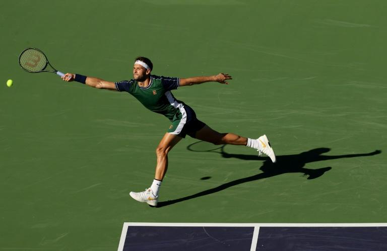 Bulgarian Grigor Dimitrov stretches to play a forehand in his Indian Wells Masters quarter-final victory over Hubert Hurkacz of Poland (AFP/CLIVE BRUNSKILL)
