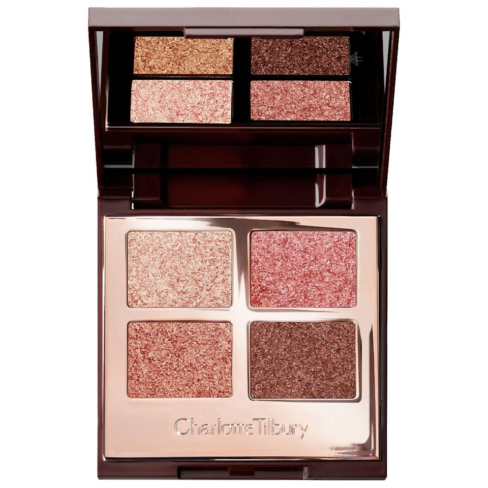 """<p>The warm neutral hues of the <a href=""""https://www.popsugar.com/buy/Charlotte-Tilbury-Palette-Pops-Luxury-Eyeshadow-Palette-497374?p_name=Charlotte%20Tilbury%20Palette%20of%20Pops%20Luxury%20Eyeshadow%20Palette&retailer=sephora.com&pid=497374&price=53&evar1=bella%3Aus&evar9=46709081&evar98=https%3A%2F%2Fwww.popsugar.com%2Fphoto-gallery%2F46709081%2Fimage%2F46709594%2FCharlotte-Tilbury-Palette-Pops-Luxury-Eyeshadow-Palette&list1=eye%20shadow%2Cbeauty%20products%2Cmakeup%20palette%2Cbeauty%20by%20popsugar&prop13=api&pdata=1"""" rel=""""nofollow"""" data-shoppable-link=""""1"""" target=""""_blank"""" class=""""ga-track"""" data-ga-category=""""Related"""" data-ga-label=""""https://www.sephora.com/product/charlotte-tilbury-palette-pops-luxury-eyeshadow-palette-P452201?icid2=products%20grid:p452201"""" data-ga-action=""""In-Line Links"""">Charlotte Tilbury Palette of Pops Luxury Eyeshadow Palette</a> ($53) will coordinate well with any outfits you packed for your trip.</p>"""