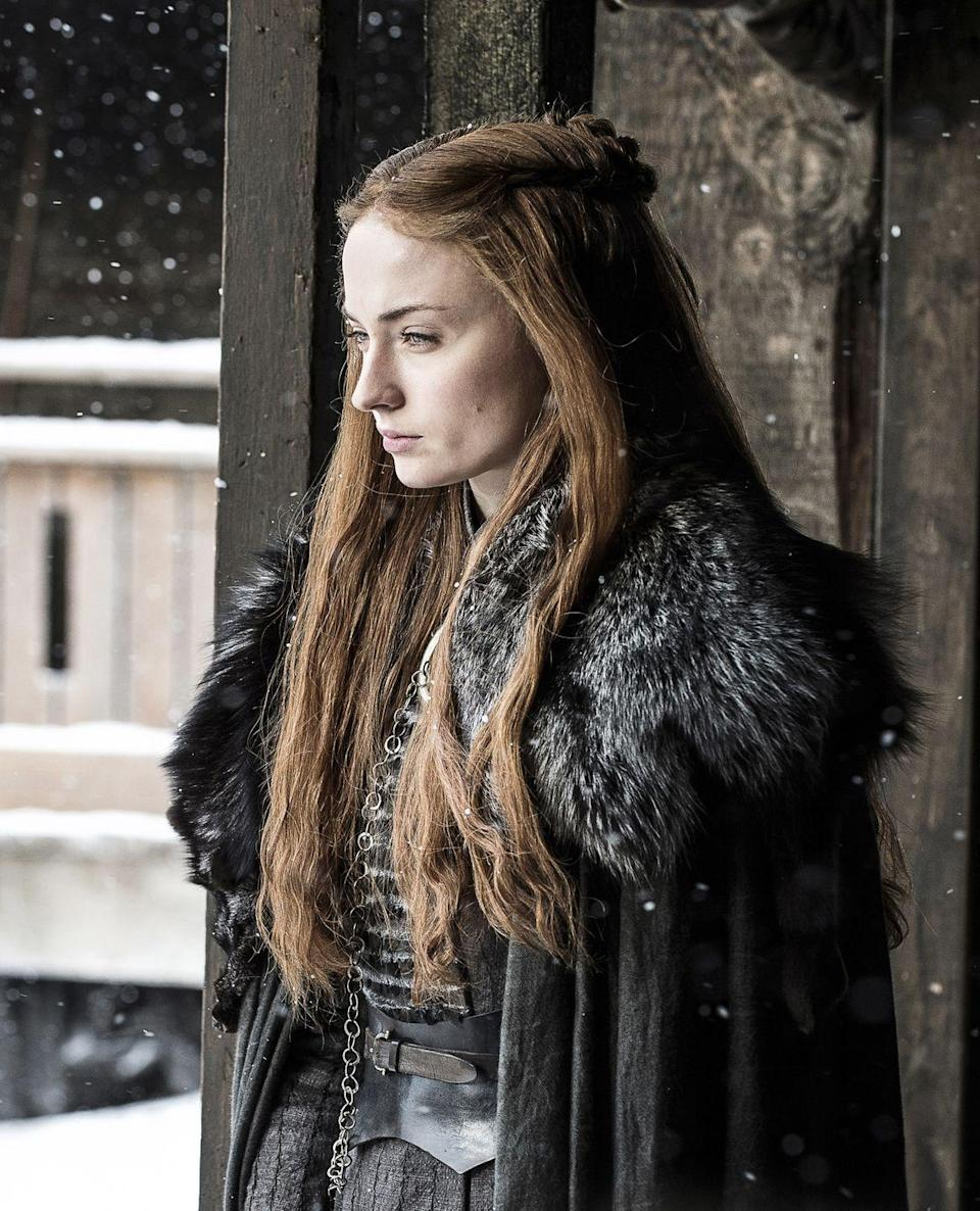 <p>The frills and bright colors of Sansa's youth are long gone, replaced by the dark uniform of the North. Rather than running away from her heritage like she did as a child, Sansa decides to embrace it, embodying the fierce direwolf that is the symbol of the House Stark.</p>