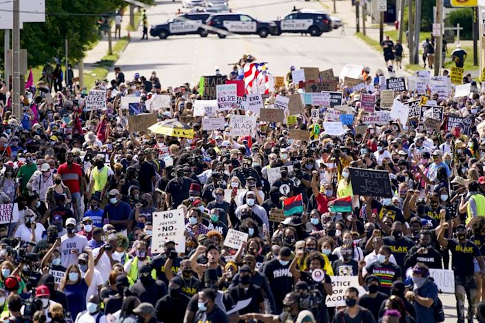 "Crowds gather to rally for Jacob Blake on Saturday in Kenosha, Wis. The city is bracing for more unrest when President Trump lands on Tuesday. <span class=""copyright"">(Associated Press)</span>"