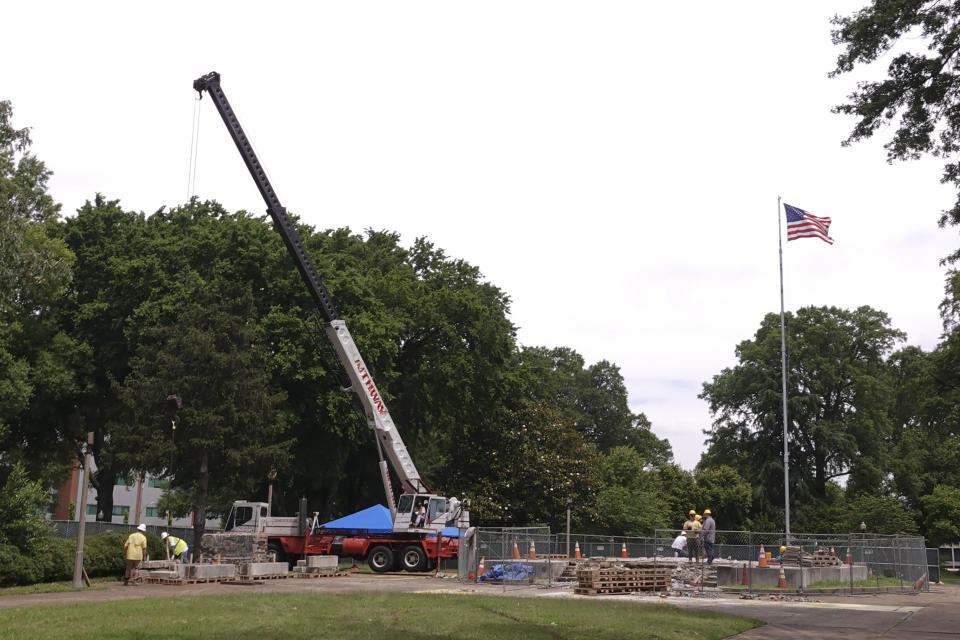Workers dig up the remains of Confederate Gen. Nathan Bedford Forrest and his wife to move the bodies from Health Sciences Park June 4, 2021, in Memphis, Tenn. With the approval of relatives, the remains will be moved to the National Confederate Museum in Columbia, Tenn. (AP Photo/Karen Pulfer Focht)