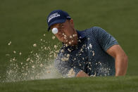 Jordan Spieth hits out of a bunker on the second hole during the first round of the Masters golf tournament on Thursday, April 8, 2021, in Augusta, Ga. (AP Photo/Gregory Bull)