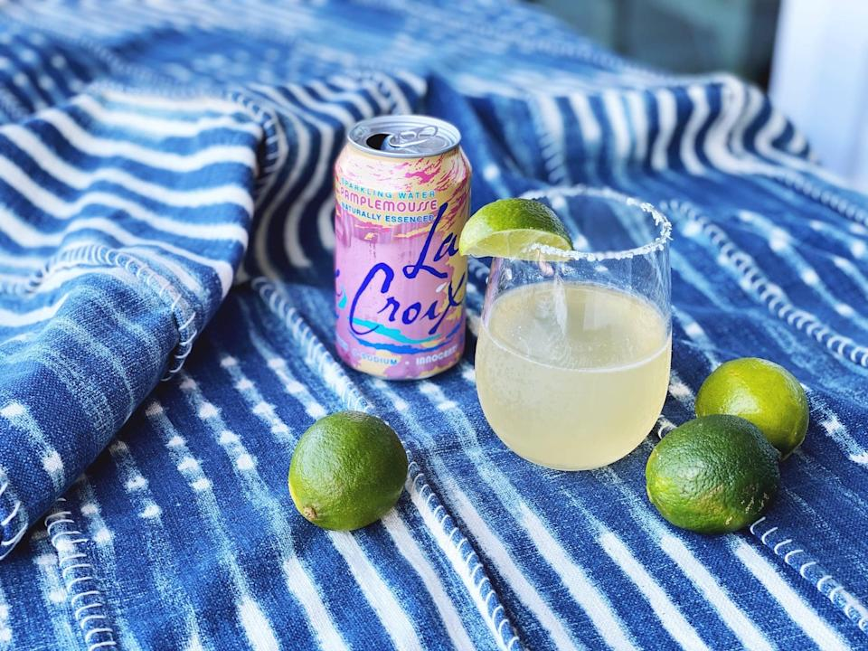"""<p>Since LaCroix has zero calories, it's no wonder this refreshing cocktail made the list! Made with just a handful of fresh ingredients, this delightful <a href=""""https://www.popsugar.com/food/lacroix-paloma-cocktail-recipe-47446238"""" class=""""link rapid-noclick-resp"""" rel=""""nofollow noopener"""" target=""""_blank"""" data-ylk=""""slk:LaCroix paloma"""">LaCroix paloma</a> can be made in minutes.</p> <p><strong>Ingredients: </strong></p> <ul> <li>5 oz. Pamplemousse LaCroix</li> <li>2 oz. tequila</li> <li>1 oz. fresh lime juice</li> <li>1 oz. Grand Marnier (or triple sec)</li> <li>Kosher salt</li> <li>Lime wedge (for serving)</li> </ul> <p><strong>Directions</strong>: Prepare the glass by rubbing the rim with a lime wedge. Fill a small plate with salt and dip the wet rim of the glass in the salt. Pour LaCroix into salt-rimmed glass. Combine tequila, lime juice, and Grand Marnier in a measuring glass or cocktail shaker. Fill with ice and stir or shake well to combine, about 20 seconds. Pour over salt-rimmed glass of LaCroix and garnish with lime wedge.</p>"""