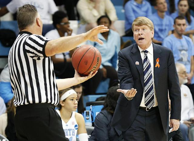 North Carolina associate head coach Andrew Calder, right, questions a call by an official during the second half of a first-round game of the NCAA college basketball tournament against UT-Martin in Chapel Hill, N.C. Sunday, March 23, 2014. (AP Photo/Ellen Ozier)