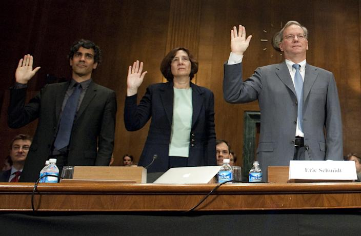 Eric Schmidt (R), then Chairman of Google, Susan Creighton (C), a partner with Wilson Sonsini Goodrich and Rosati, and Jeremy Stoppelman (L), co-founder and CEO of Yelp, are sworn in prior to testifying before the US Senate Judiciary Committee's Subcommittee on Antitrust, Competition Policy and Consumer Rights. (Photo credit should read SAUL LOEB/AFP via Getty Images)