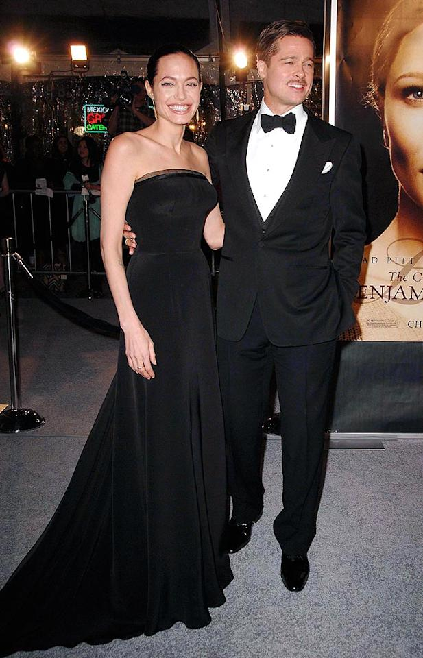 """Angelina Jolie and Brad Pitt were all smiles at Monday's premiere of """"The Curious Case of Benjamin Button."""" Angelina donned a gorgeous black Versace gown while Brad chose a classic tux. Scott Kirkland/<a href=""""http://www.infdaily.com"""" target=""""new"""">INFDaily.com</a> - December 8, 2008"""