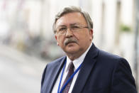 Russia's Governor to the International Atomic Energy Agency (IAEA), Mikhail Ulyanov, addresses the media near the 'Grand Hotel Vienna' where where closed-door nuclear talks take place in Vienna, Austria, Saturday, June 12, 2021. (AP Photo/Florian Schroetter)