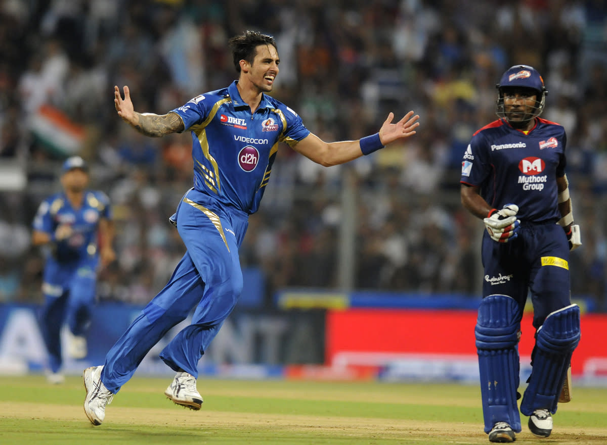 Mitchell Johnson of Mumbai Indians celebrate the wicket of Mahela Jayawardene captain of Delhi Daredevils during match 10 of the Pepsi Indian Premier League ( IPL) 2013  between The Mumbai Indians and the Delhi Daredevils held at the Wankhede Stadium in Mumbai on 9th April 2013 ..Photo by Pal Pillai-IPL-SPORTZPICS ..Use of this image is subject to the terms and conditions as outlined by the BCCI. These terms can be found by following this link:..https://ec.yimg.com/ec?url=http%3a%2f%2fwww.sportzpics.co.za%2fimage%2fI0000SoRagM2cIEc&t=1500627081&sig=GFtlbltCv5f7E9_D1OL7aw--~C