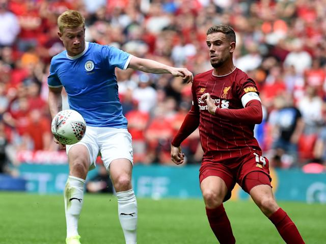 Will Jordan Henderson, right, be able to nullify Kevin De Bruyne?: Getty