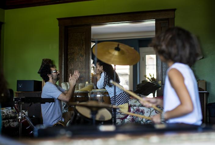 "Music producer Gabe Roth teaches rhythm to Allison Furbush while his son Sylvester Roth keeps the beat on the drums during music class. <span class=""copyright"">(Gina Ferazzi / Los Angeles Times)</span>"