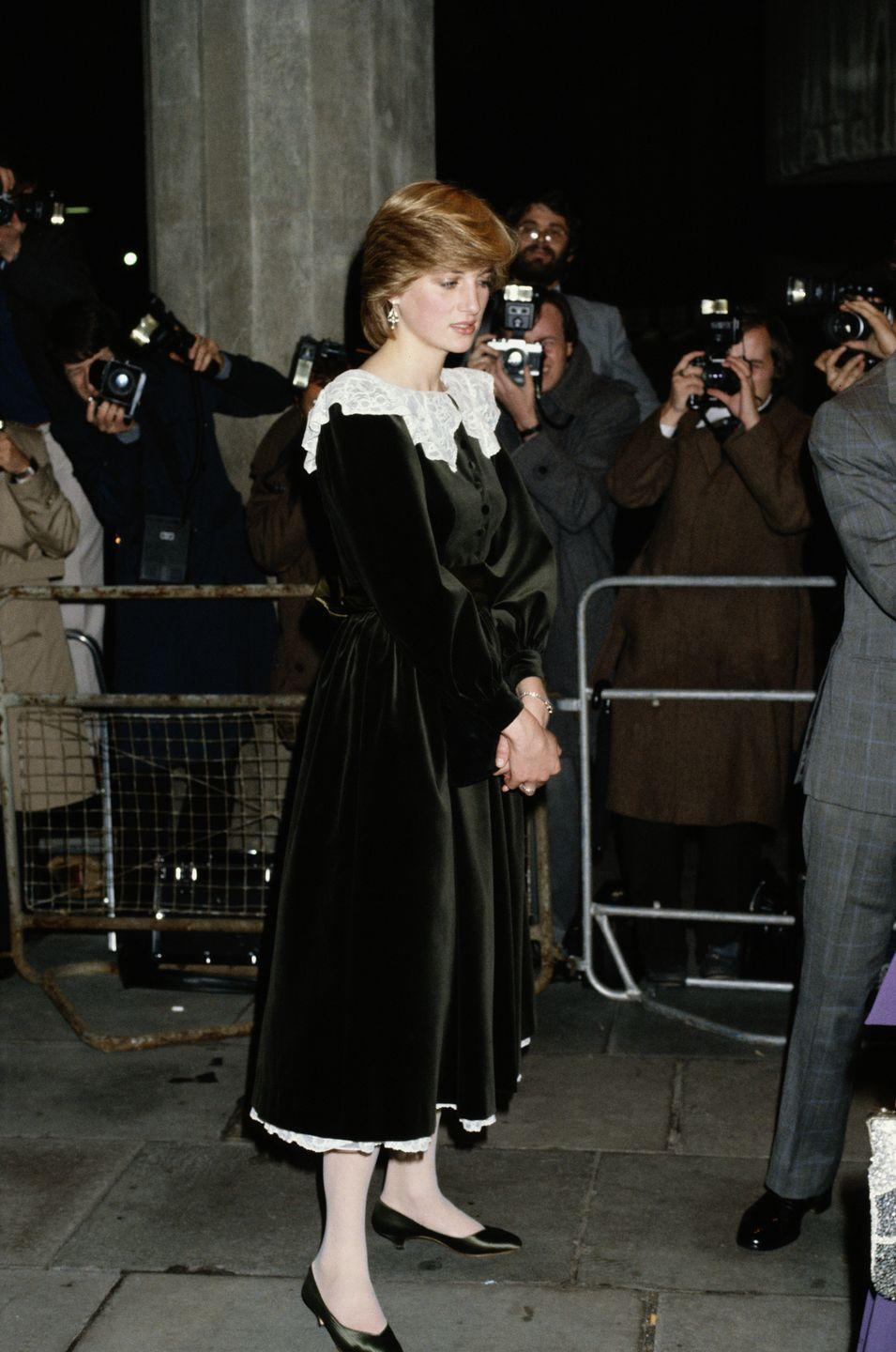 <p>Princess Diana, wearing a velvet Gina Frattini dress with a lace pilgrim neckline, at the National Film Theatre on the South Bank in London, November 1981.</p>