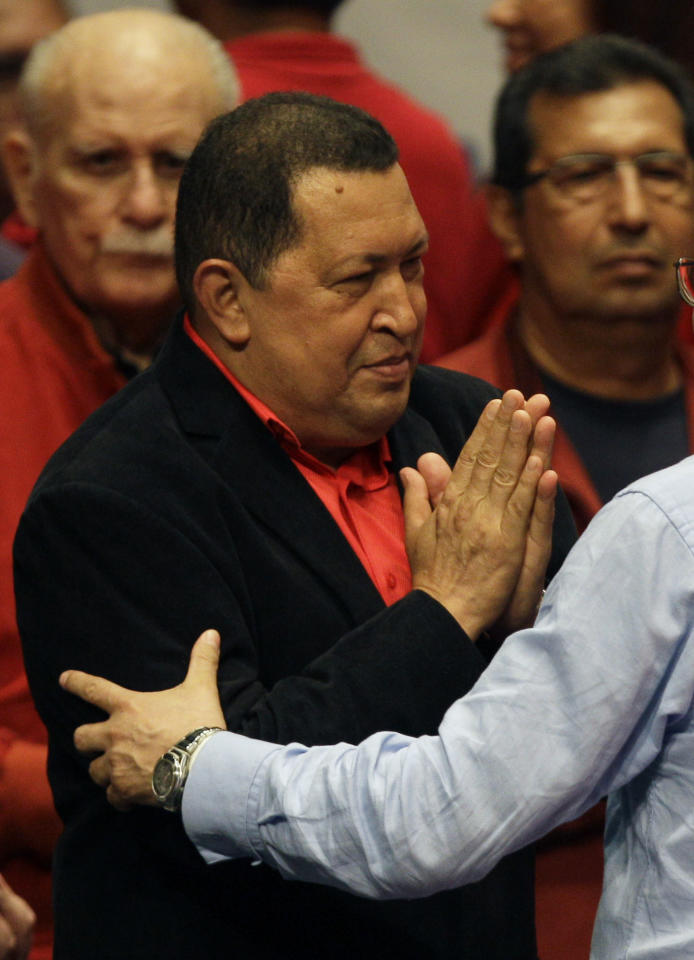 Venezuela's President Hugo Chavez gestures as he attends an event event honoring him at the Teresa Carreno theater in Caracas, Venezuela, Thursday, Feb. 23, 2012. Chavez is headed to Cuba Friday for surgery to remove a potentially cancerous tumor while the nation's congress on Thursday unanimously approved permission for Chavez to leave, a formality required by the nation's constitution. (AP Photo/Fernando Llano)