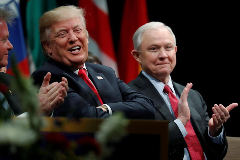President Donald Trump with Attorney General Jeff Sessions at a graduation ceremony at the FBI Academy in Quantico, Virginia, on Dec. 15. (Jonathan Ernst / Reuters)