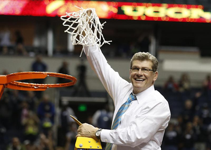 Connecticut head coach Geno Auriemma holds the net after the second half of the championship game against Notre Dame in the Final Four of the NCAA women's college basketball tournament, Tuesday, April 8, 2014, in Nashville, Tenn. Connecticut won 79-58. (AP Photo/John Bazemore)