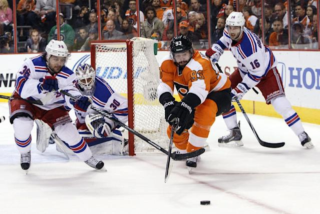 Philadelphia Flyers' Jakub Voracek, center right, of Czech Republic, goes after the puck along with New York Rangers' Mats Zuccarello, left, of Norway as Henrik Lundqvist, center left, of Sweden, and Derick Brassard, right, defend during the first period in Game 6 of an NHL hockey first-round playoff series, Tuesday, April 29, 2014, in Philadelphia. (AP Photo/Chris Szagola)