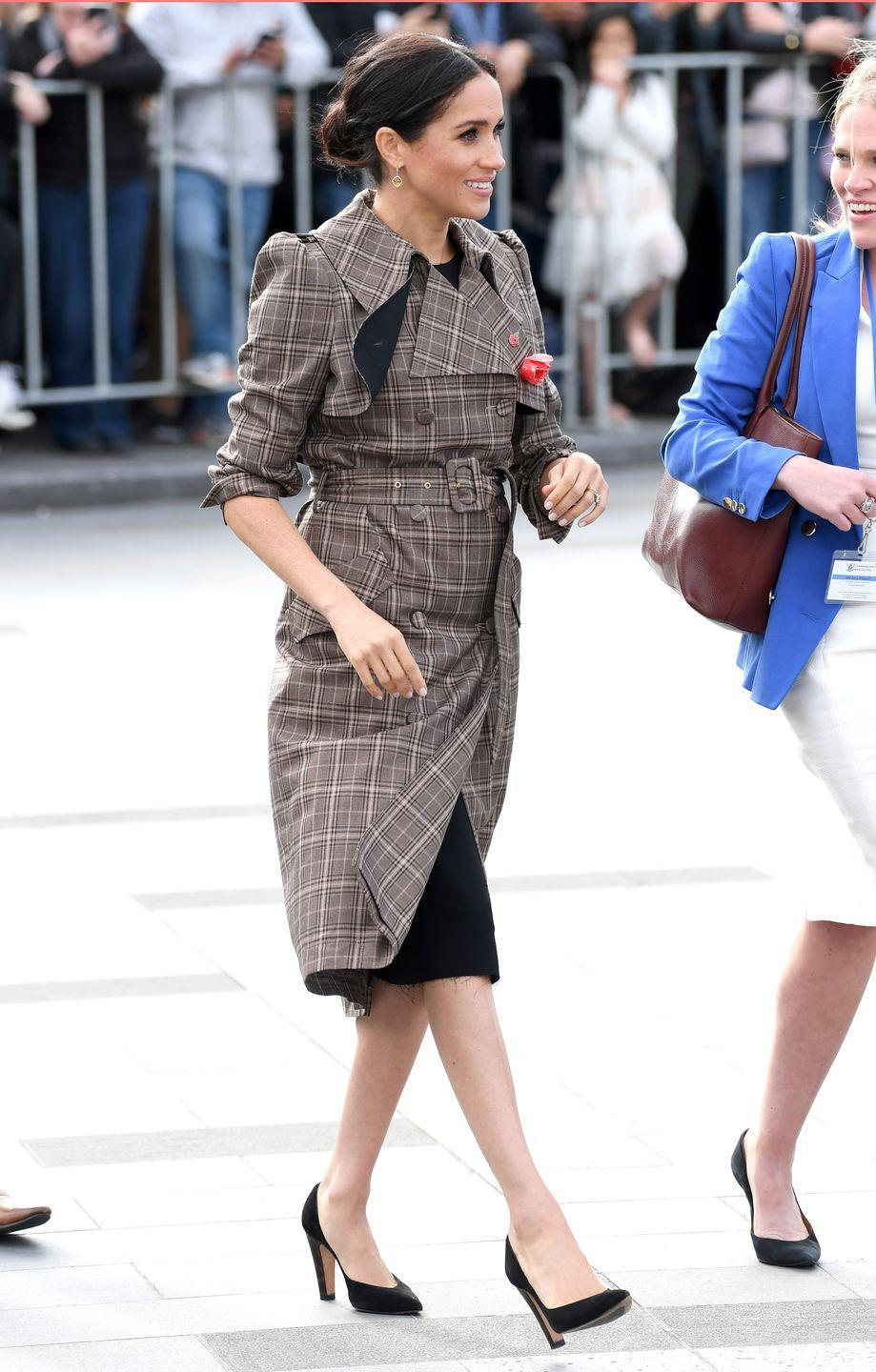 <p>Later that same month, Meghan was spotted wearing a similar ensemble by Karen Walker to the National War Memorial in New Zealand.</p>