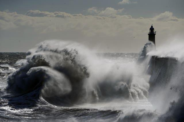 Waves crash against the Tynemouth Lighthouse on the North East coast