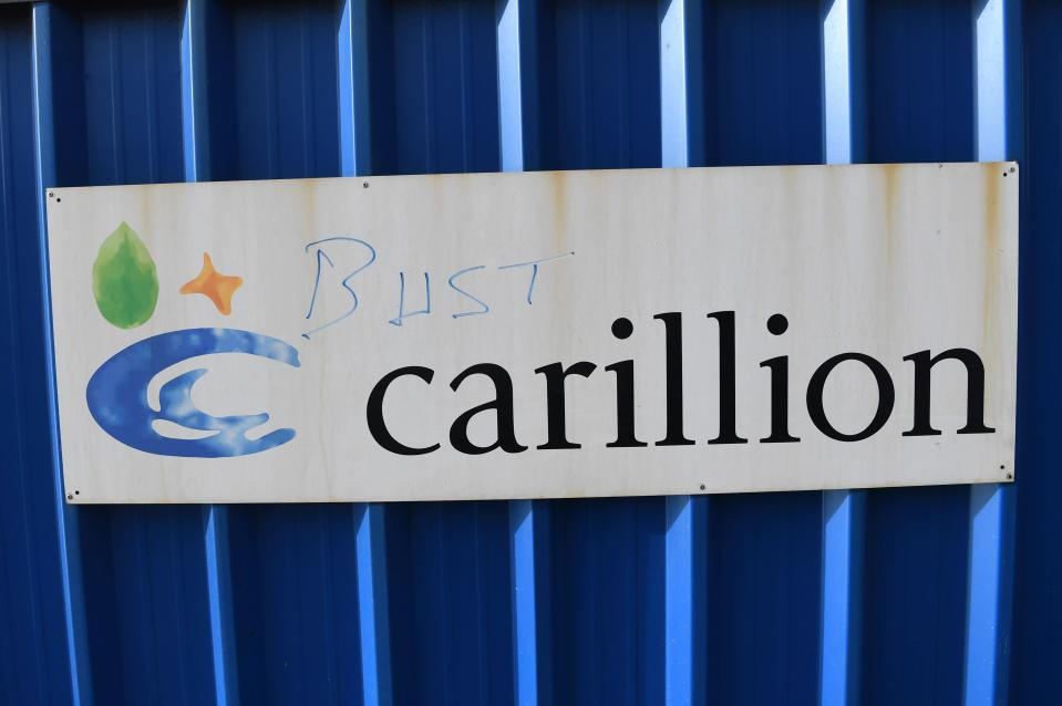 A picture shows the branding of British construction company Carillion defaced with the words 'bust' on the hoarding at the collapsed company's construction site at the Royal Liverpool University Hospital in Liverpool. Photo: Paul Ellis/AFP/Getty Images