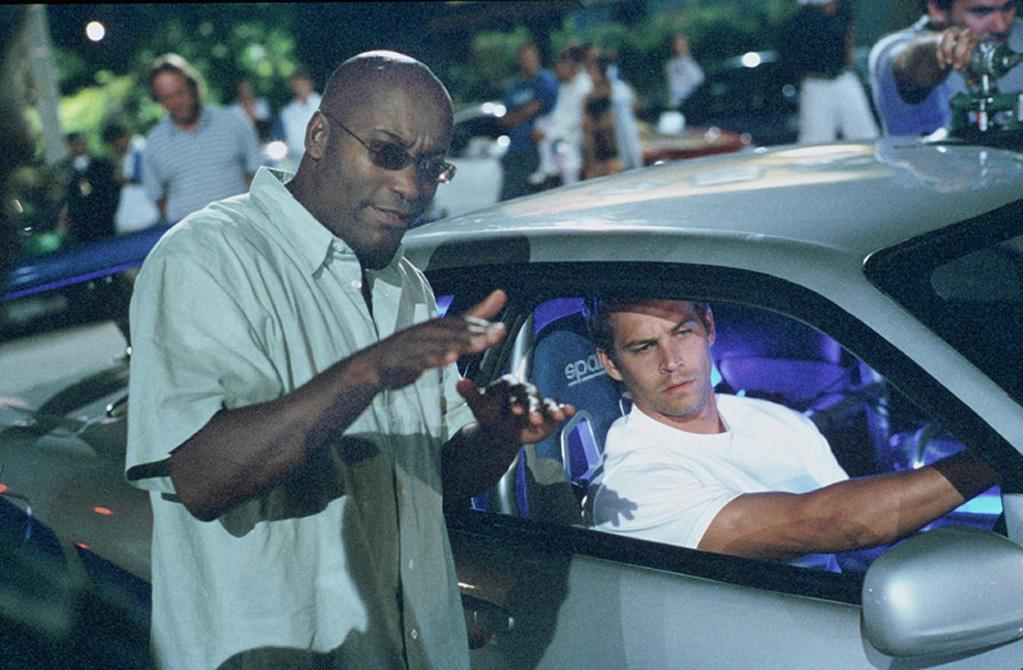 """Director <a href=""""http://movies.yahoo.com/movie/contributor/1800024265"""">John Singleton</a> and <a href=""""http://movies.yahoo.com/movie/contributor/1800019262"""">Paul Walker</a> on the set of Universal Pictures' <a href=""""http://movies.yahoo.com/movie/1808403981/info"""">2 Fast 2 Furious</a> - 2003"""
