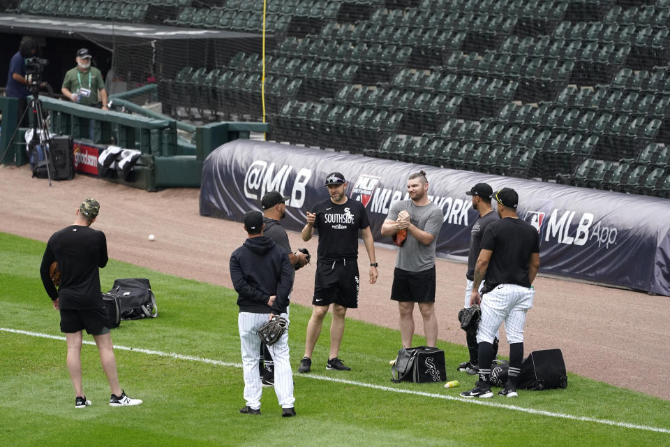 Chicago White Sox pitching coach Ethan Katz, center, talks with his players after Game 4 of an ALDS baseball game was postponed due to a forecast of inclement weather Monday, Oct. 11, 2021, in Chicago. The makeup game is scheduled for Tuesday afternoon at Guaranteed Rate Field. (AP Photo/Charles Rex Arbogast)