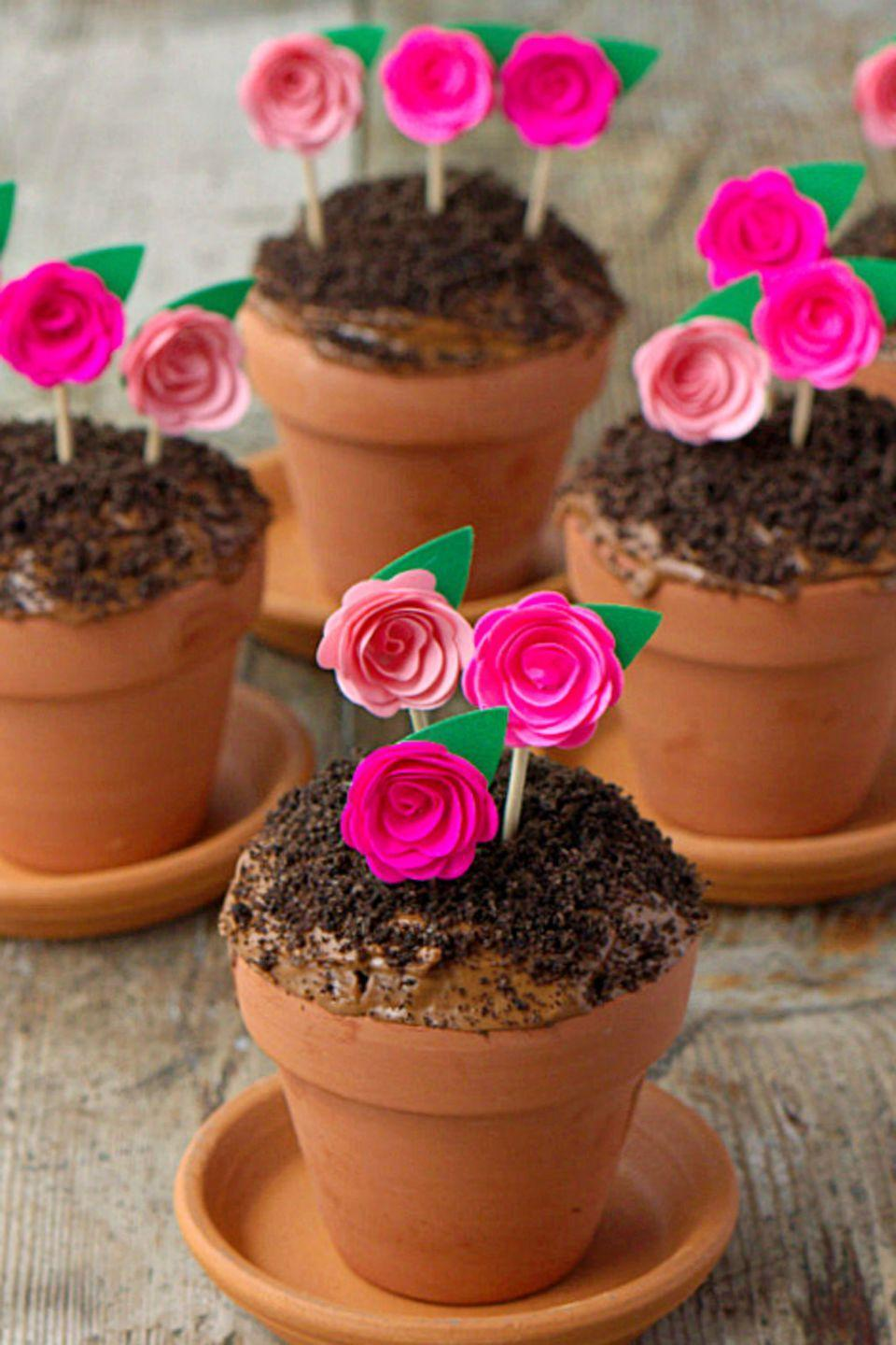 """<p>Put down your gardening tools and pick up your hand mixer to create these adorable, kid-friendly treats. </p><p>Get the full recipe from <a href=""""https://thissillygirlskitchen.com/flowerpot-cupcakes/"""" rel=""""nofollow noopener"""" target=""""_blank"""" data-ylk=""""slk:This Silly Girls Kitchen"""" class=""""link rapid-noclick-resp"""">This Silly Girls Kitchen</a>.</p>"""