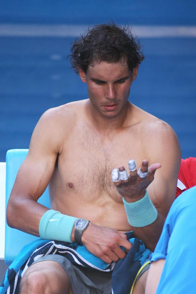 MELBOURNE, AUSTRALIA - JANUARY 22: Rafael Nadal of Spain looks at his blistered hand in his quarterfinal match against Grigor Dimitrov of Bulgariaduring day 10 of the 2014 Australian Open at Melbourne Park on January 22, 2014 in Melbourne, Australia. (Photo by Michael Dodge/Getty Images)
