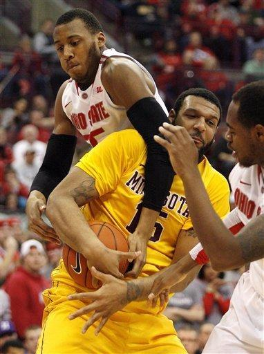 Ohio State's Trey McDonald, top, fouls Minnesota's Maurice Walker (15) during the first half of an NCAA college basketball game, Wednesday, Feb. 20, 2013, in Columbus, Ohio. (AP Photo/Mike Munden)