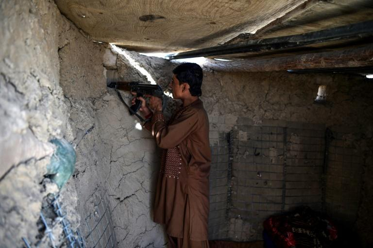 Walls in Aziz Abad have been destroyed by fighting and the roads are all but abandoned
