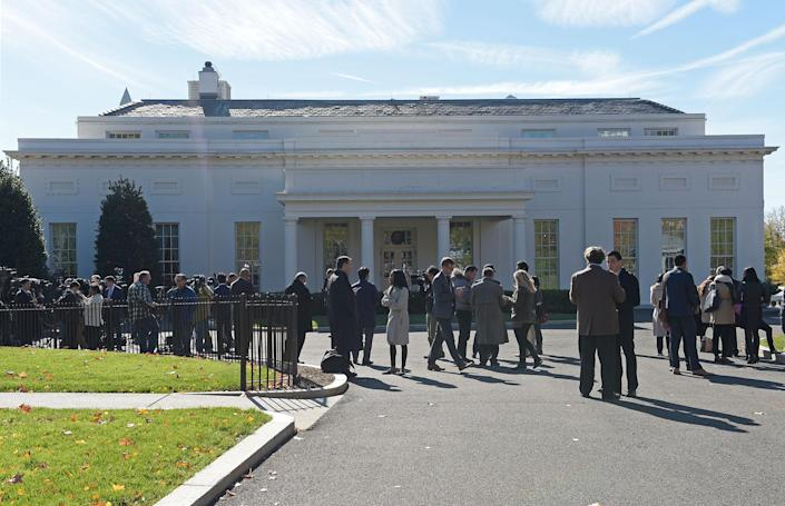 <p>People gather outside the West Wing of the White House in Washington on Nov. 10, 2016, as they wait for President-elect Donald Trump to arrive for his meeting with President Obama. (AP Photo/Susan Walsh) </p>