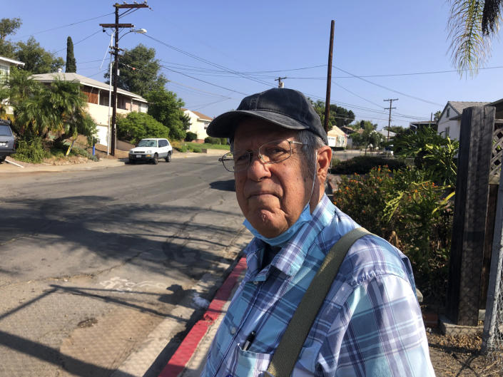 Joe Cusumano, 77, poses for a photo on Tuesday, Sept. 14, 2021, outside a San Diego polling site after casting his ballot in favor of recalling California Gov. Gavin Newsom. Cusumano, a barber, said he wants Newsom to be replaced by conservative radio host Larry Elder who he said is more knowledgeable. (AP Photo by Julie Watson)