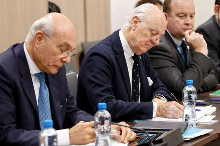 UN Special Envoy to the Secretary-General for Syria Staffan de Mistura and UN Deputy Special Envoy for Syria Ramzy Ezzeldin Ramzy, left, attend a round of negotiation with Nasr al-Hariri (not pictured), Head of the Syrian Negotiation Commission, during the Intra Syria talks at the European headquarters of the United Nations in Geneva, Switzerland December 13, 2017. REUTERS/Salvatore Di Nolfi/Pool