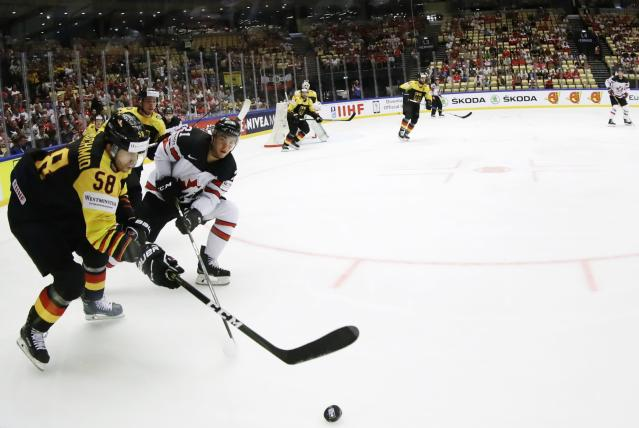 Ice Hockey - 2018 IIHF World Championships - Group B - Canada v Germany - Jyske Bank Boxen - Herning, Denmark - May 15, 2018 - Tyson Jost of Canada in action with Markus Eisenchmid of Germany. Picture taken with a fisheye lens. REUTERS/David W Cerny