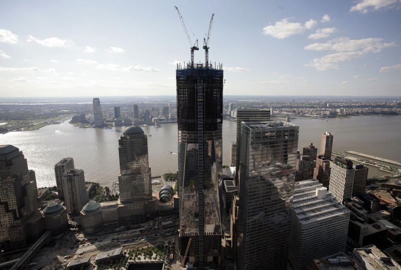 One World Trade Center rises above the lower Manhattan skyline in this aerial photo, Tuesday, Aug. 30, 2011 in New York. Behind the tower are the Hudson River and New Jersey.  Sept.  11, 2011 will mark the tenth anniversary of the terrorist attacks in the United States. (AP Photo/Mark Lennihan)