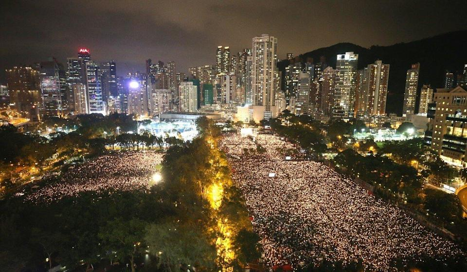 Thousand of Hongkongers raise their candles during the June 4 vigil at Victoria Park in 2019. Photo: Winson Wong