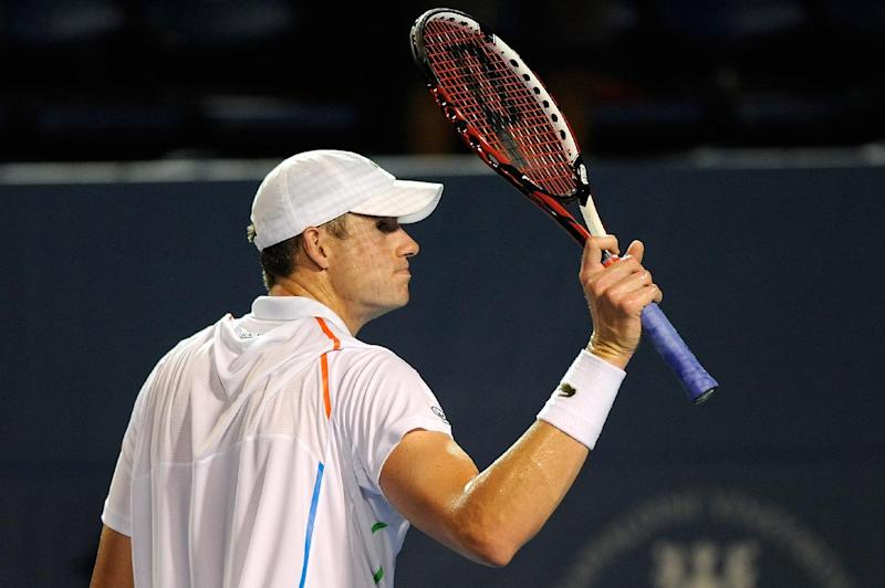 John Isner waves to the crowd after defeating Mikhail Kukushkin of Kazakhstan during the Winston-Salem Open at Wake Forest University on August 20, 2014